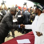 New HOS, Mr Sunday Olayinka Owoeye being congratulated by Ogbeni rauf Aregbesola, Governor of the Sate of Osun