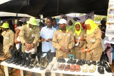 A cross Section of Cadets of Osun Youth Empowerment Scheme (O-Yes), displaying thier self made products, during their passing out ceremony, held at the Orientation Camp of the NYsC, Ede, State of Osun on Tuesday 29-01-2013