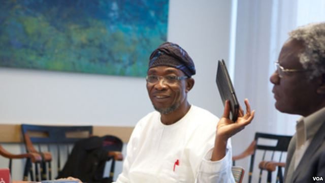 Ogbeni Rauf Aregbesola holding the Opon Imo tablet