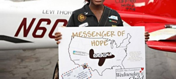 Kimberly Anyadike, 15, stands in front of her single-engine Cessna plane during her historic cross-country flight