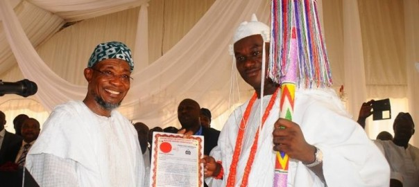 Ooni of Ife Coronation Ceremony - Governor Rauf Aregbesola presents staff of office and certificate to new Ooni Oba Enitan Adeyeye Ogunwusi