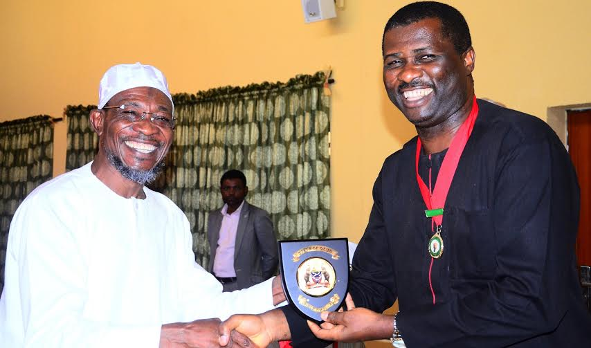 Governor State of Osun, Ogbeni Rauf Aregbesola presenting the State Emblem to the Representative of the National President,Nigerian Institute of Architects, (NIA) Third Vice President, Arch. Enyi Ben Eboh during a Courtesy Visit to the Governor, at the Government House, Osogbo, on Monday 30/05/2016.