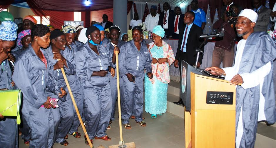 Governor State of Osun, Ogbeni Rauf Aregbesola with Highway Managers and Staff of Osun Waste Management Agency (OWMA), during the official Handing Over of Customized Uniforms for Road Managers by OWMA, sponsored by Sterling Bank Plc to Mark this Year 2016 National Environmental Sanitation, at City Hall, Olonkoro, Osogbo on Tuesday 28/6/2016.