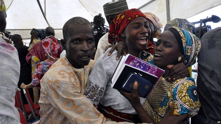21 Released Chibok School Girls Unite With Parents In Abuja