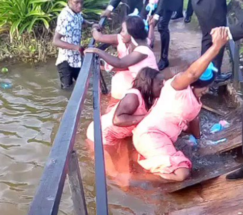 PHOTO OF THE DAY: Bridesmaids Fall Into Stream Before Getting To Venue