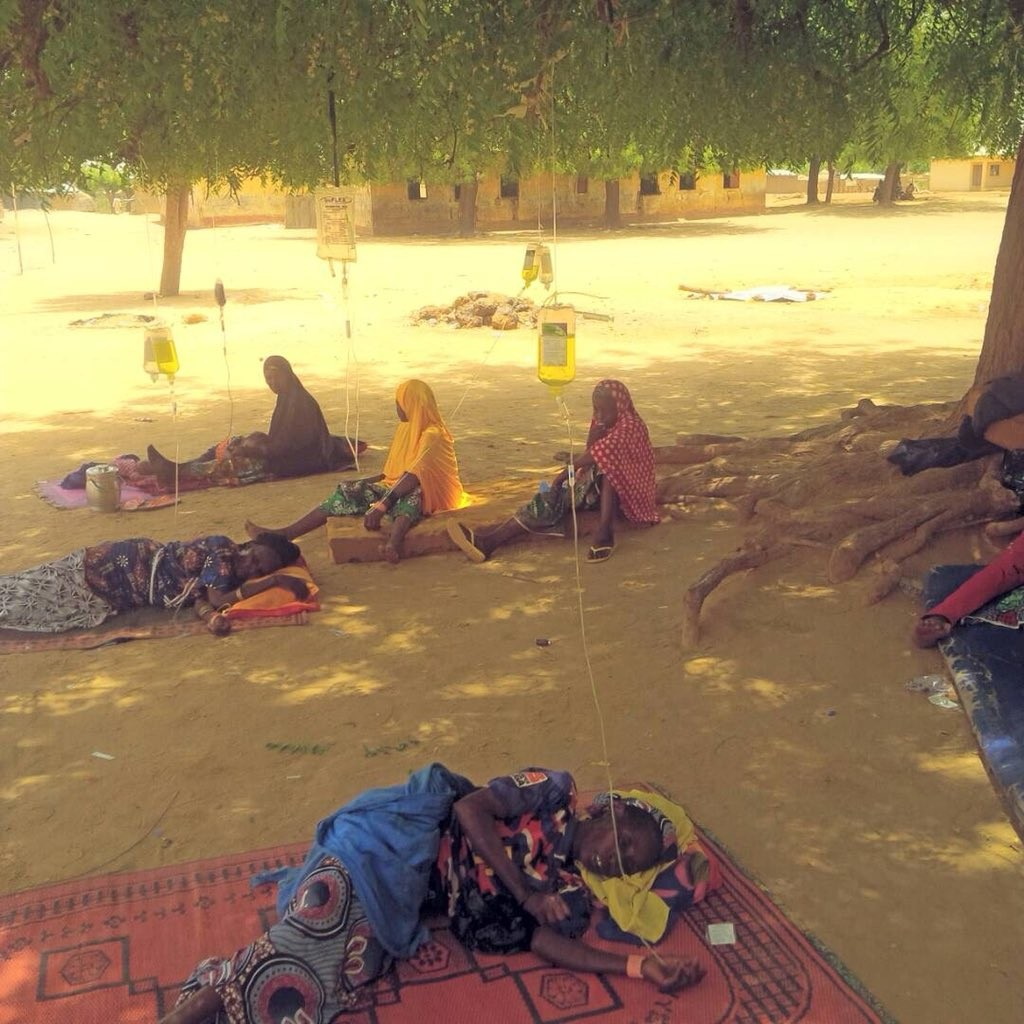 Photo Of The Day: Shocking Picture Of Sokoto Residents Receiving Drips Under A Tree